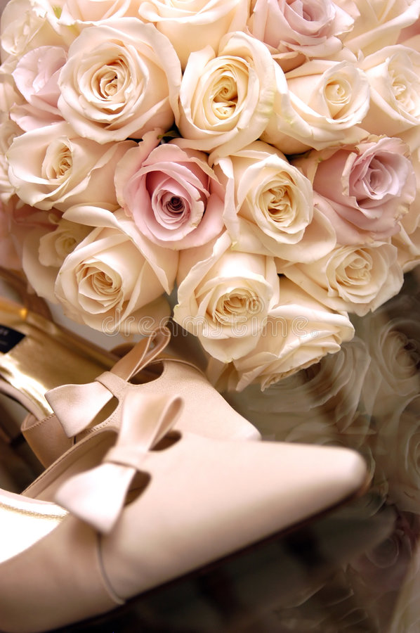 Bouquet and Shoes - Flowers for a wedding royalty free stock image