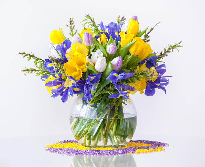 Bouquet of Spring Flowers. Bouquet of daffodils tulips and fleur-de-lises on white background. Typical spring and Easter flowers stock images