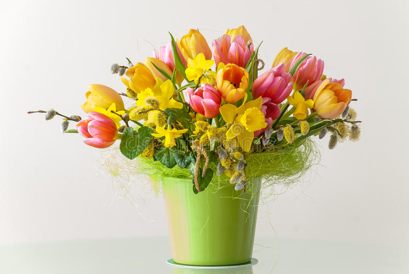 Bouquet of Spring Flowers. Bouquet of daffodils tulips and fleur-de-lises on white background. Typical spring and Easter flowers royalty free stock images
