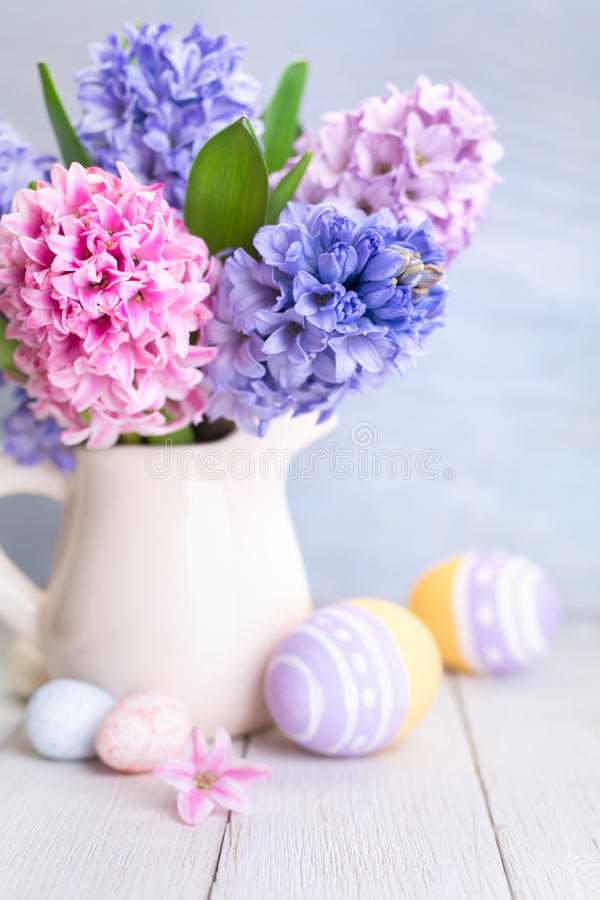 Bouquet of spring flowers and Easter Eggs. Happy Easter. Bouquet of spring flowers and Easter Eggs. Selective focus royalty free stock image