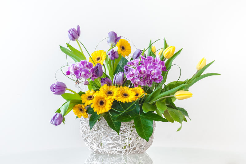 Bouquet of Spring Flowers. Bouquet of gerberas, tulips and hiacynts on white background. Typical spring and Easter flowers stock photo