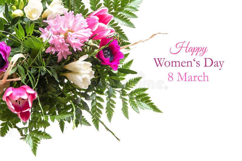 Bouquet of spring flowers isolated on white with text, happy wom. Colorful bouquet of spring flowers isolated on white as a corner background, sample text in the royalty free stock photos