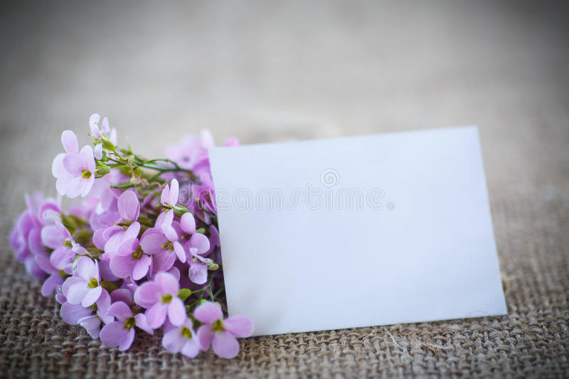 Bouquet of spring flowers. On the table of burlap stock photos