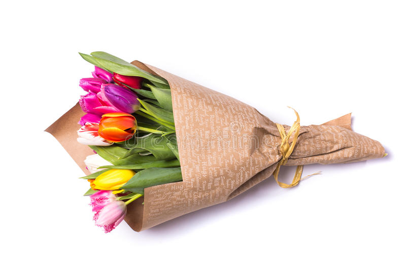 Bouquet of spring tulips flowers wrapped in paper. Isolated on white background royalty free stock photography