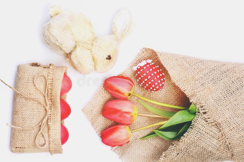 Bouquet of spring tulips for holiday near bunny. stock photos