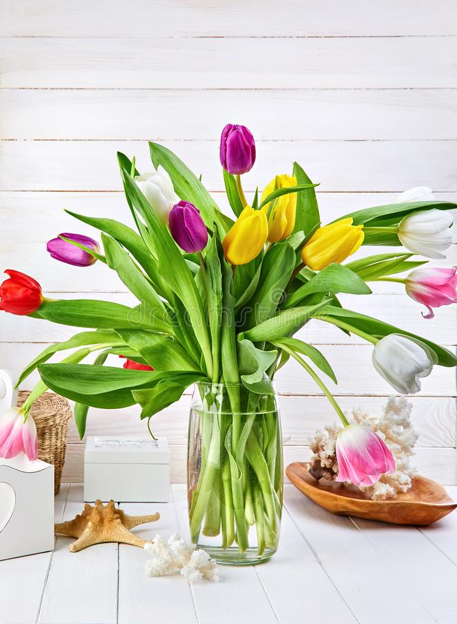 Bouquet spring tulips on white wooden board royalty free stock photos