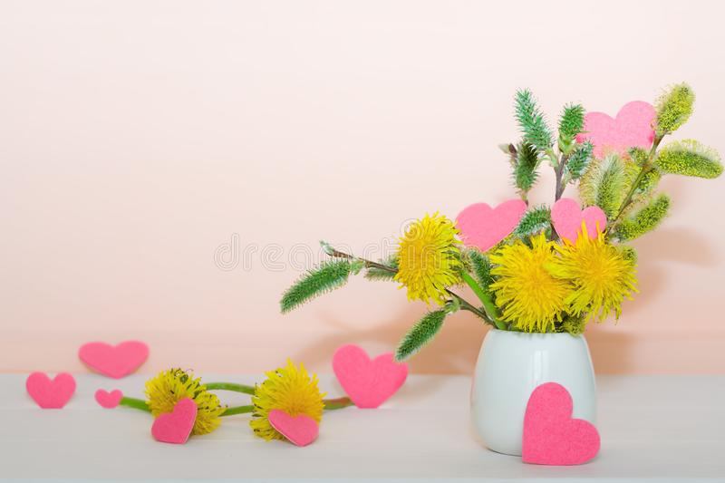 Bouquet Of Spring Willow Branches With Dandelion Flowers In A Vase