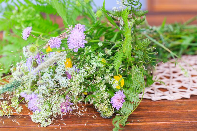 A bouquet of summer wild herbs and flowers in nature, the summer solstice. Summer sun celebration. Ligo in Latvia, Europe stock photography