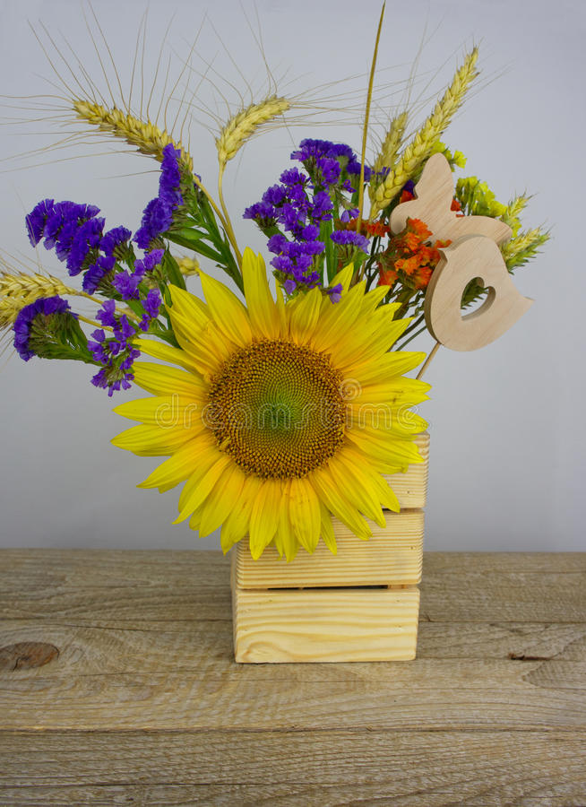 Bouquet of sunflowers, daisies, cornflowers, ears of wheat and l royalty free stock images
