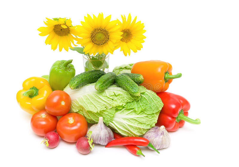 Bouquet of sunflowers and vegetables. horizontal photo. Bouquet of three sunflowers and fresh vegetables on a white background. horizontal photo royalty free stock images