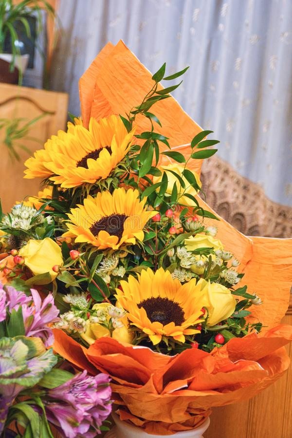 Bouquet of three sunflowers royalty free stock photos