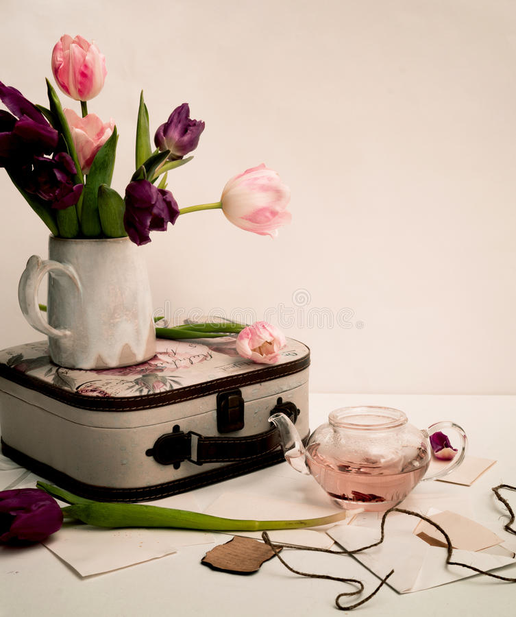 Bouquet of tulips and an old suitcase on the table, Provence, Shabby Chic.  royalty free stock images