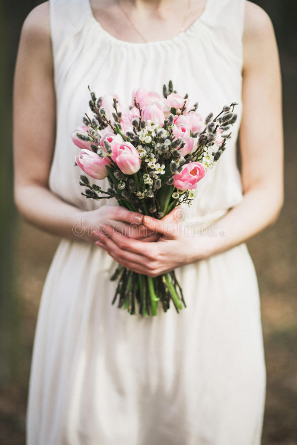 Bouquet of tulips and pussy-willow in hands stock photo