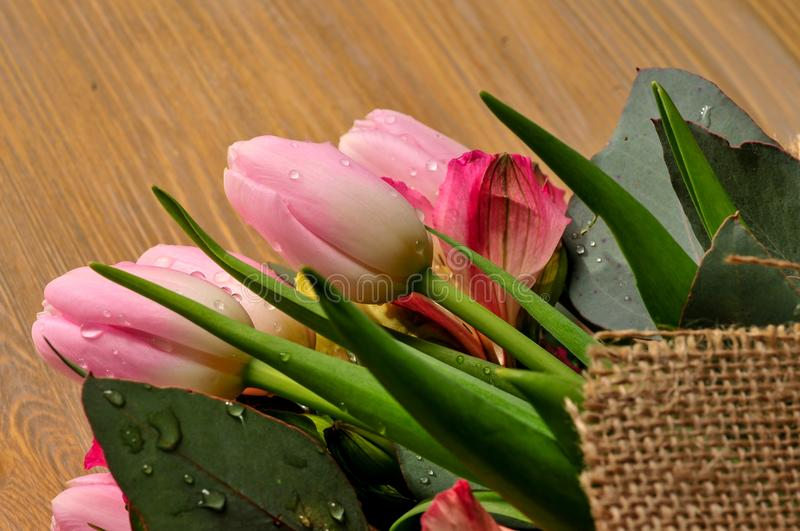 Bouquet of tulips on the table with a note stock photos