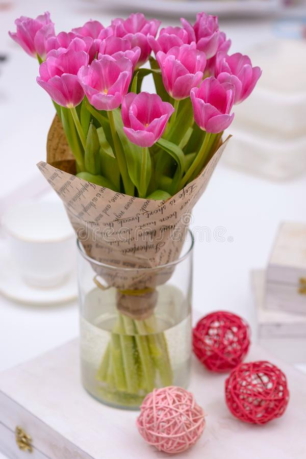 Bouquet tulips in vase royalty free stock images