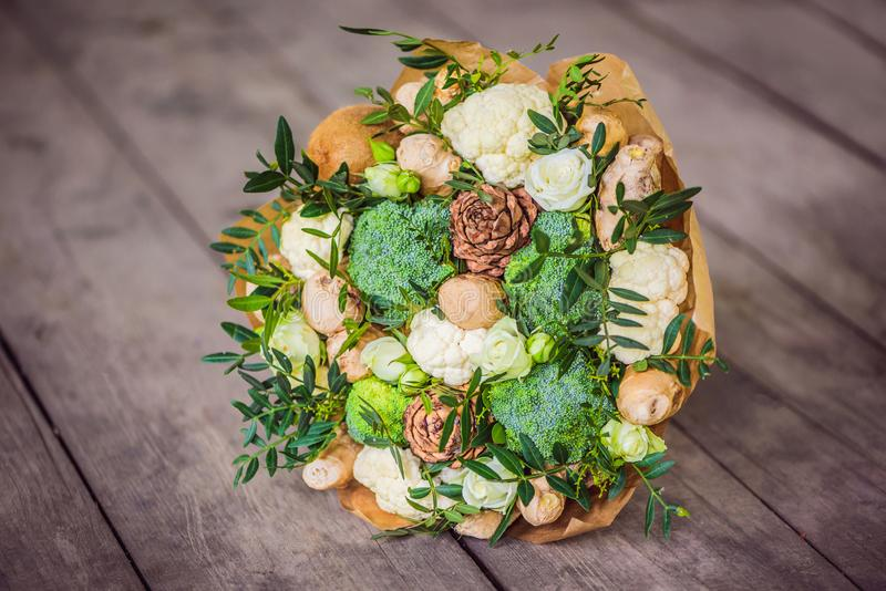 Bouquet of vegetables and fruits, useful gift for a healthy lifestyle, a detox diet. broccoli, cauliflower, ginger stock photography