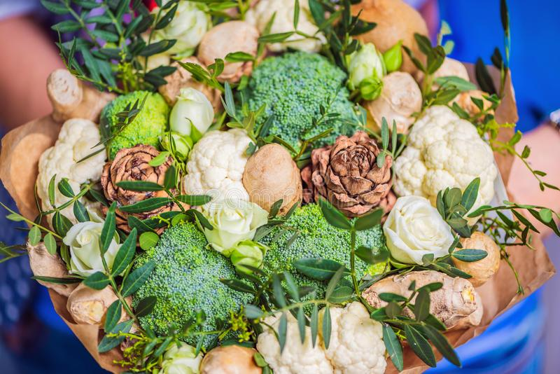 Bouquet of vegetables and fruits, useful gift for a healthy lifestyle, a detox diet. broccoli, cauliflower, ginger royalty free stock photos