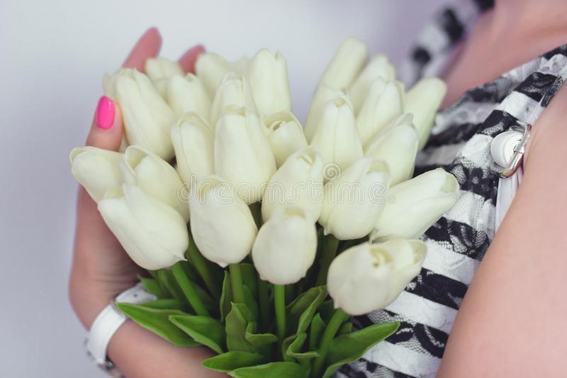 Girl Holding Beautiful Spring Tulip On Color Background