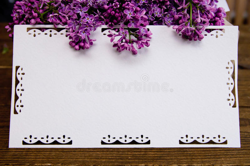 Bouquet of white lilac on a wooden table royalty free stock photos