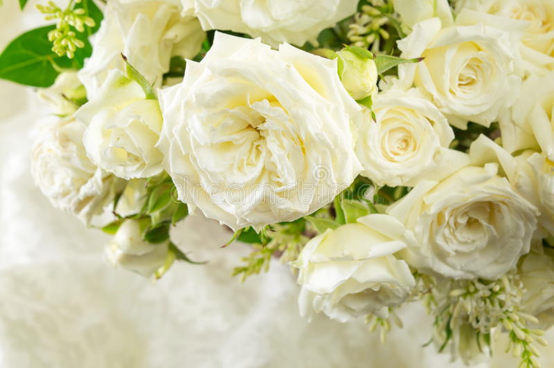 Bouquet of white roses on a cloth stock images