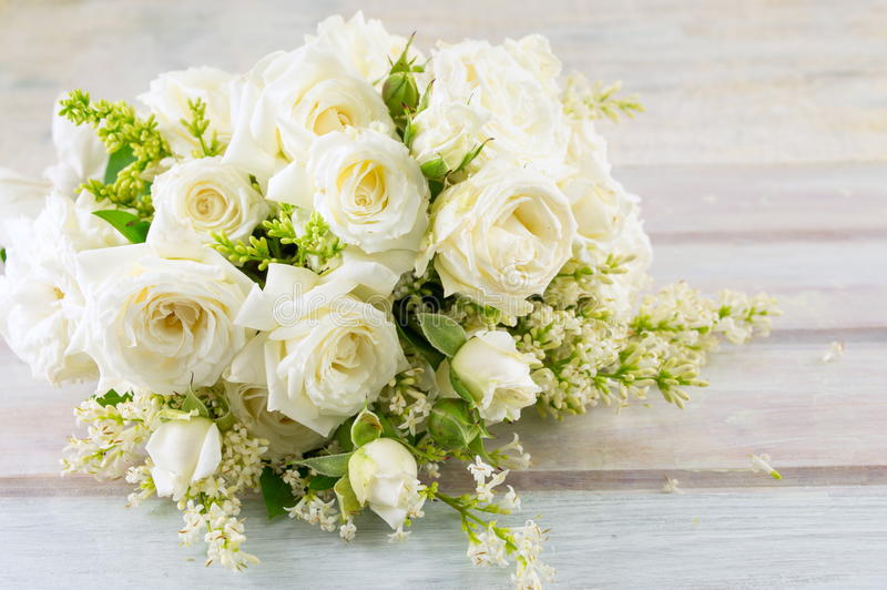 Bouquet of white roses on a table royalty free stock photography