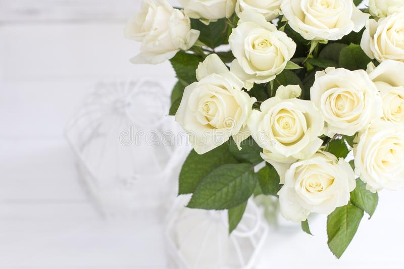 Bouquet of white roses in a vase. stock images