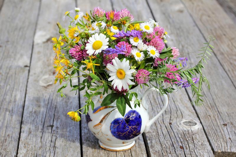 Bouquet of wildflowers in a jug stock images