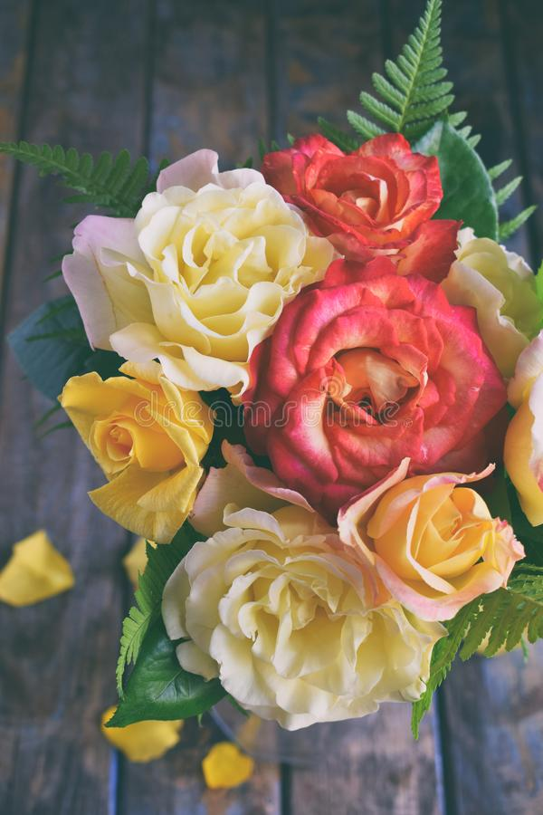 Bouquet of yellow and red roses. Flowers. Valentine or Wedding Theme. Romantic. Copy space.  stock images