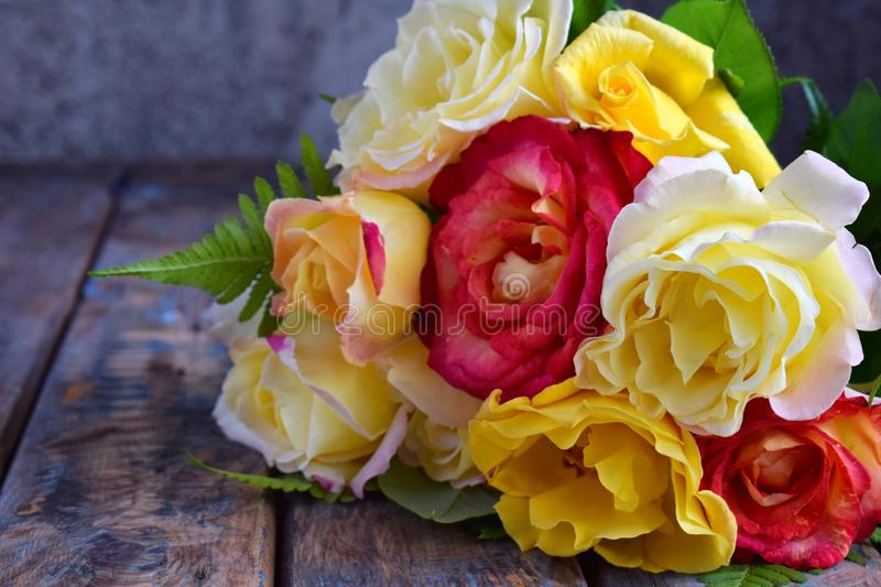 Bouquet of yellow and red roses. Flowers. Valentine or Wedding Theme. Romantic. Copy space.  royalty free stock images