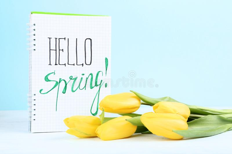Tulips with text Hello Spring stock photo