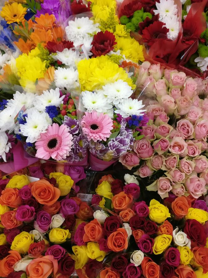 Bouquets of coloured flowers. Bouquets of coloured roses and other flowers with different colours like yellow, red, pink, orange, green and white stock photos
