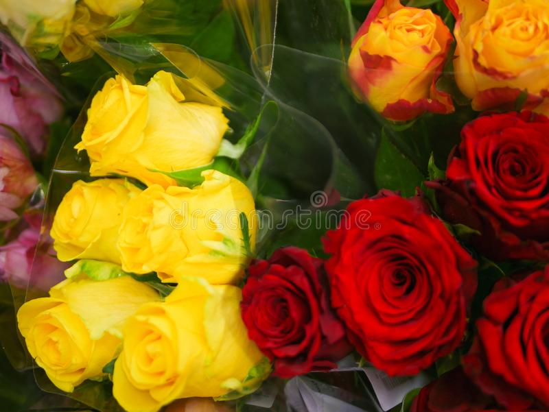Bouquets of flowers. Many bouquets of flowers. Roses, lilies, chrysanthemums. Close-up royalty free stock image