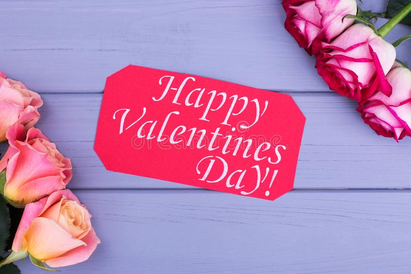 Bouquets and Happy Valentine`s Day card. Greeting card and roses on gray background stock photo