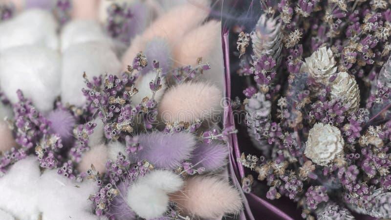 Bouquets of lavender, cotton, lagurus in kraft paper stock image