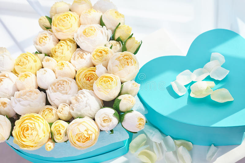 Bouquets of paper flowers in cardboard boxes stock images