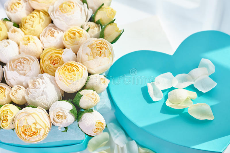 Bouquets of paper flowers in cardboard boxes stock photo