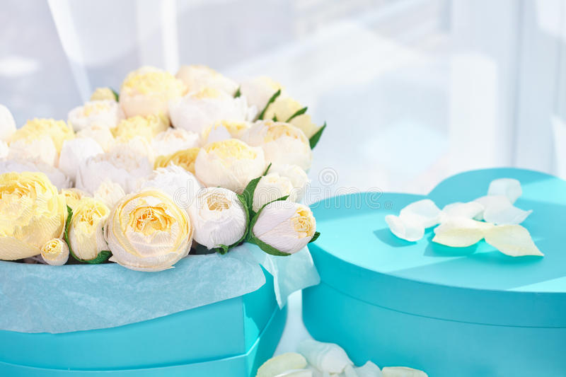 Bouquets of paper flowers in cardboard boxes stock photography