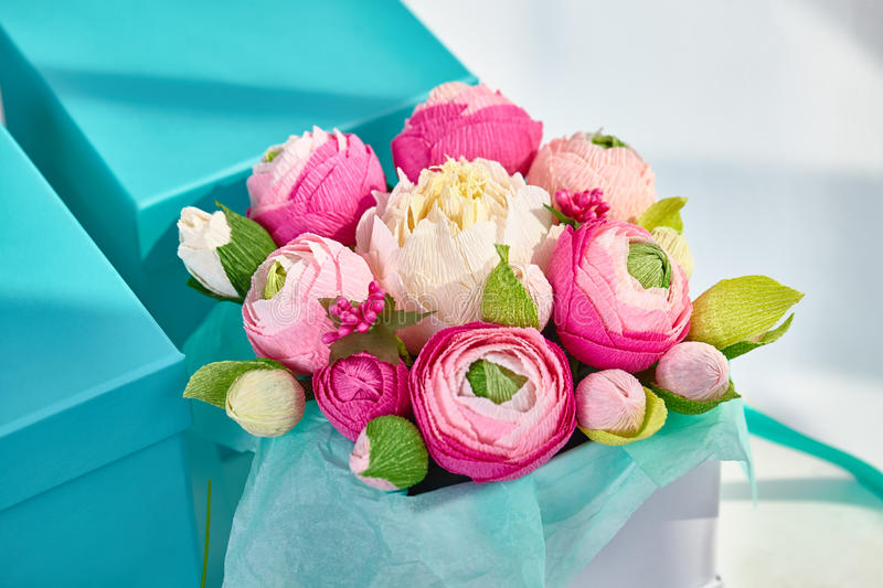 Bouquets of paper flowers in a cardboard square boxes royalty free stock photos