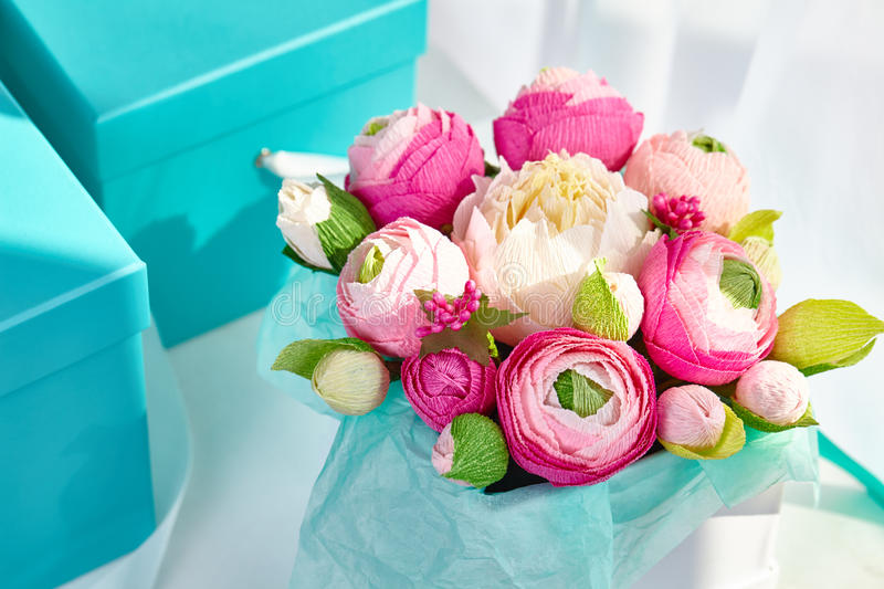 Bouquets of paper flowers in a cardboard square boxes stock image