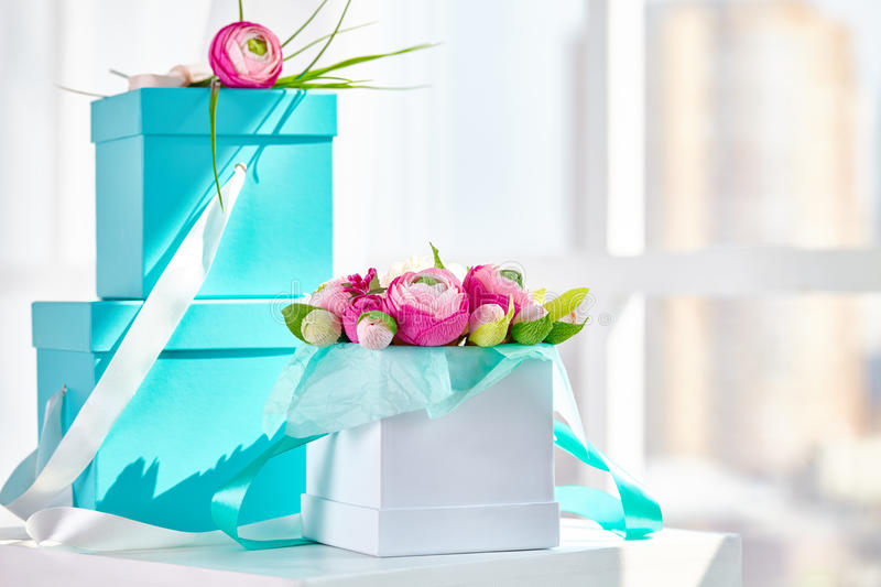 Bouquets of paper flowers in a cardboard square boxes royalty free stock images