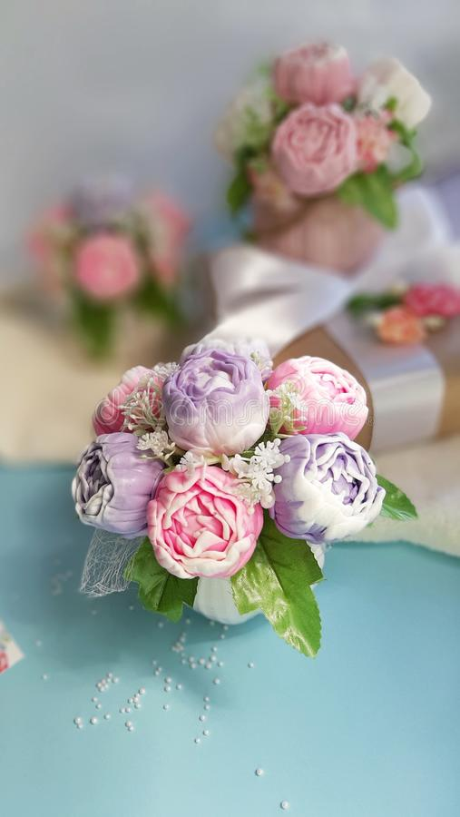 Bouquets of peonies on blue surface in front of white wall. Happy Mothers day, Womens day, Valentines day, Birthday or wedding greeting concept. Bouquets of stock photos