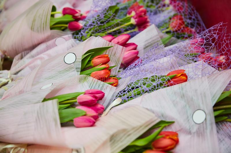 Bouquets of tulips lie on a table on top of each other. Bouquets of tulips lie on a table on top royalty free stock photos