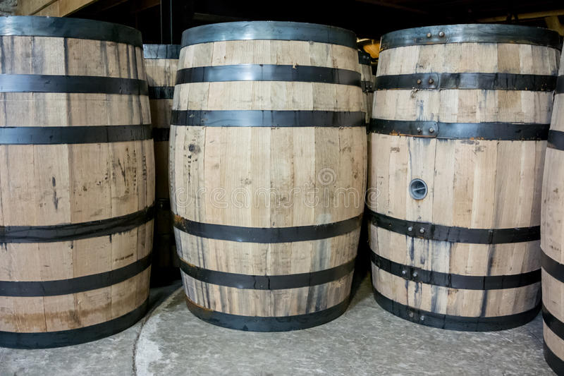 Bourbon Barrels from Side. Barrels of bourbon ready to be moved to storage for aging royalty free stock photography