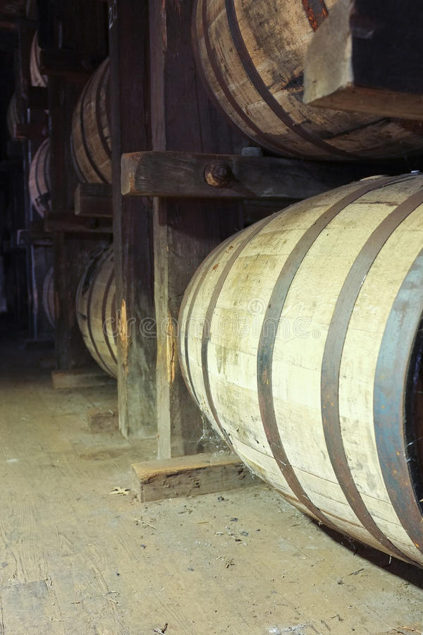 Bourbon Barrels. Barrels of bourbon whiskey in a bourbon warehouse. Aging makes bourbon mellow and flavorful royalty free stock image