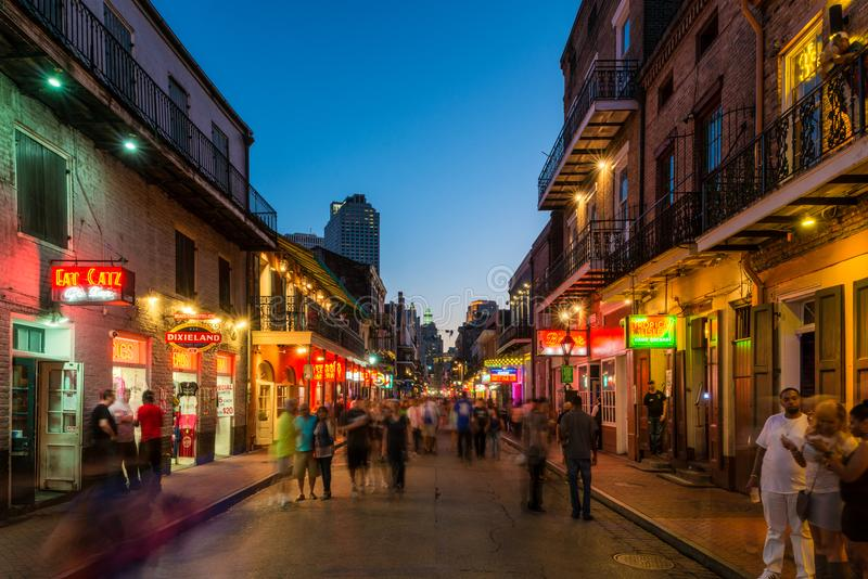Bourbon Street New Orleans at Dusk. The Famous Bourbon Street at nightfall in the French Quarter of New Orleans, Louisiana, United States stock photos