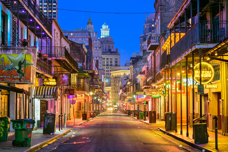 Bourbon Street New Orleans. NEW ORLEANS, LOUISIANA - MAY 10, 2016: Bourbon Street in the early morning. The renown nightlife destination is in the heart of the royalty free stock photos