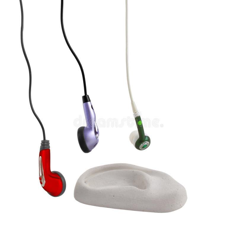 Bourgeons d'oreille avec l'oreille photo stock
