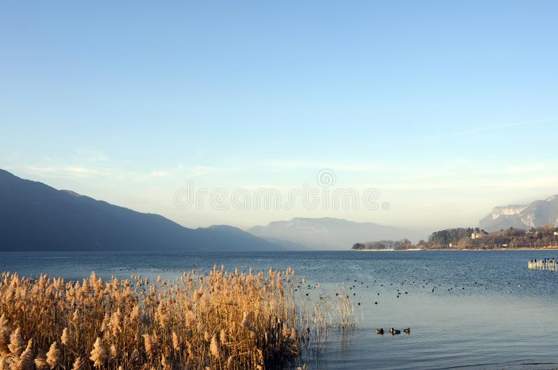 Bourget lake and mountains. Large view of north Bourget lake and mountains from Chambotte, Savoy royalty free stock images