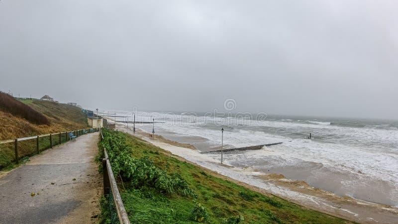 Bournemouth, Dorset / United Kingdom - February 9, 2020: Storm Ciara landing on Southwest English coast with huge crashing waves,. Very strong wind and rain stock photos