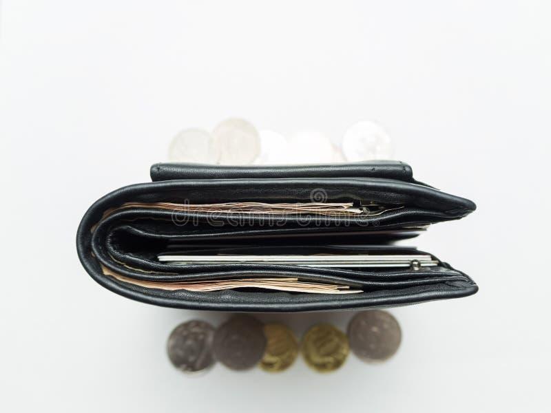 Bourse noire avec la vue supérieure d'argent de papier et de fer photos stock